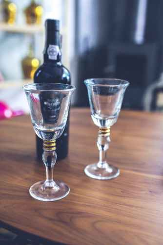 two wine glasses bottle
